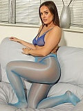 Frankie Laine is wearing blue sheer bra, panties and glossy pantyhose for your personal pleasure